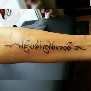 Tekst tattoo Mischa